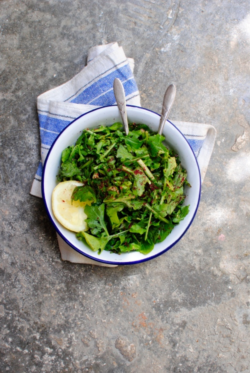Wild green salad with lemon, olive oil and sumac.