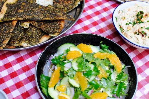 Fresh spring salad with orange, cilantro, mint, purple onion, lemon and olive oil.